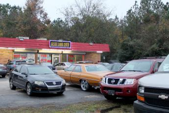 Vehicles fill the parking lot at Arcade Gaming Center in Callahan just after 5 p.m. Friday, also parking in the grass near the traffic lanes of U.S. 1. Adult arcades in Nassau County have nearly doubled in number of establishments since they were shut down in Duval County in October.