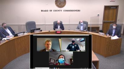 Nassau County commissioners, including Aaron Bell via the Internet, listen to Nassau County Emergency Management Director Greg Foster provide an update on COVID-19 and vaccinations.
