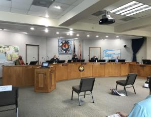 The Fernandina Beach City Commission donned masks and Commission Chambers were reconfigured with seats six feet apart to conform to social distancing for the first in-person meeting of the City Commission since rules regarding public meetings were relaxed by Gov. Ron DeSantis. JULIA ROBERTS/NEWS-LEADER