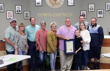 Hilliard Town Council President John Beasley is joined by family after receiving recognition for 20 years of service to the town.