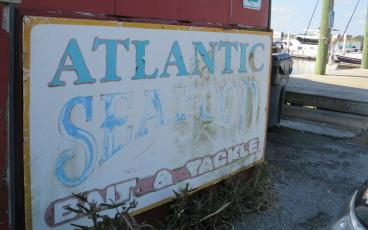 "Atlantic Seafood Bait and Tackle, located at the west end of Ash Street at the Fernandina Harbor Marina, adds to the ""grittiness"" that is part of a working waterfront, Tammi Kocsack said. Operator Charlie Taylor said he believes the building dates from the 1950s, and the business has been under the purview of his family since 1975. JULIA ROBERTS/NEWS-LEADER"