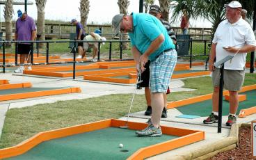 Professional and amateur putters met at Putt-Putt at Main Beach in September 2015 to compete in the 56th annual Professional Putters Association national championship. The PPA returns Sept. 14 for the 61st annual national championship. Joe Lea, above right, won in 2015. More photos, 7B. BETH JONES/NEWS-LEADER