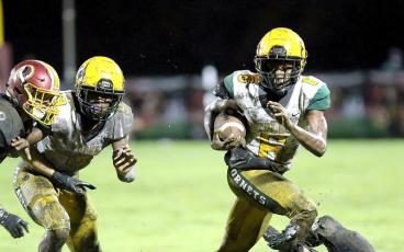 Jalen Holmes carries the ball for the Yulee Hornets Friday in Callahan. BRIAN LACROSS/SPECIAL