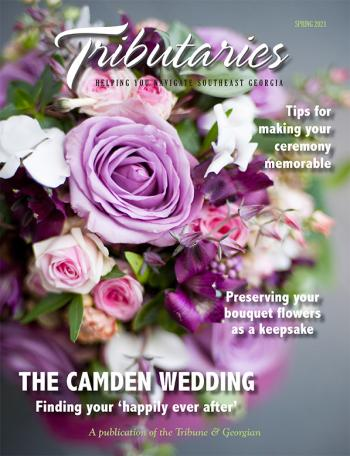 "Cover of the Winter 2021 ""The Camden Wedding"" Edition of Tributaries magazine; image is of a flower bouquet on a gray background"